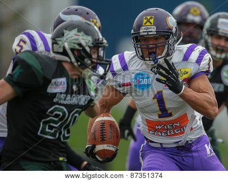 VIENNA, AUSTRIA - APRIL 13, 2014: RB Emmanuel Pan-Sok Moody (#1 Vikings) runs with the ball.