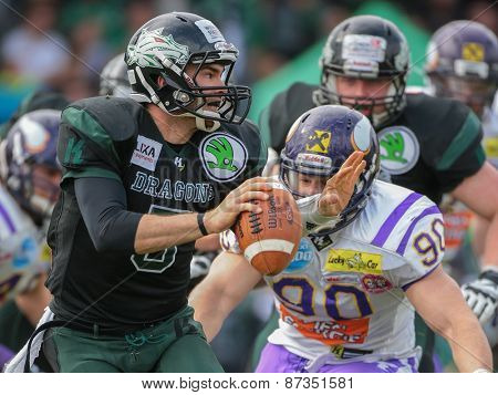 VIENNA, AUSTRIA - APRIL 13, 2014: QB Cary Grossart (#5 Dragons) runs with the ball.