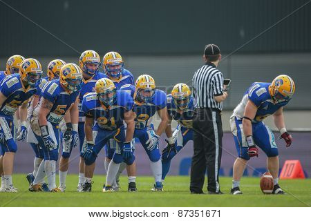 GRAZ, AUSTRIA - APRIL 26, 2014: The team of the Graz Giants prepares for the kick-off.