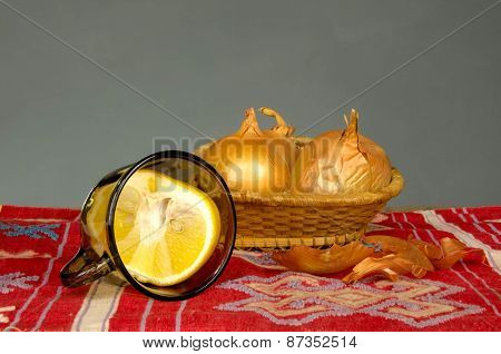 onion and lemon on a linen tablecloth