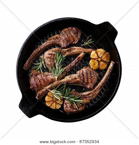Roasted Lamb Ribs With Rosemary And Garlic On Grill Pan On Dark Background