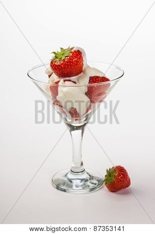 Strawberries And Cream In A Glass On A White Background