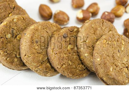 Oatmeal Cookies And Hazelnuts On White