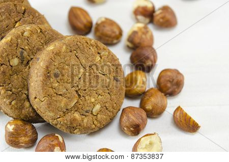 Oatmeal Cookie And Hazelnuts On White