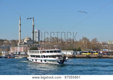 ISTANBUL, TURKEY - MARCH 21, 2014: Ferry boat across Bosporus strait against Kadikoy coast. The ferry is the fastest and cheapest way to traverse Bosporus strait