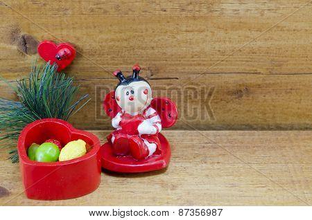 Heart Shaped Ceramic Box And A Ladybug Ornament
