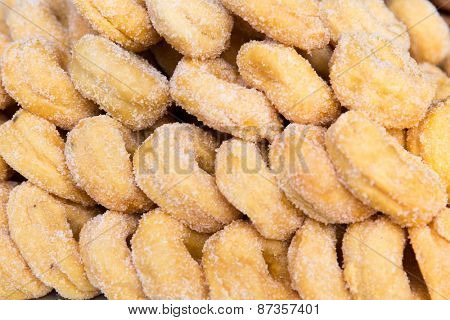 cooking, asian kitchen, sale and food concept - sugared donuts texture