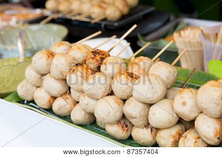 cooking, asian kitchen, sale and food concept - meatballs at street market