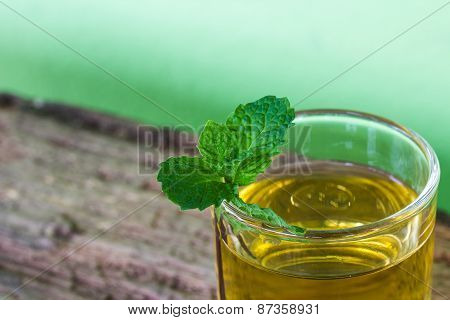 Lemonade With Mint On A Dark Wood Background. Tinting. Selective Focus