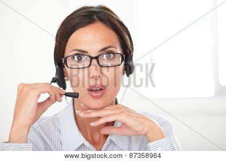 Professional Employee Speaking On The Headphones
