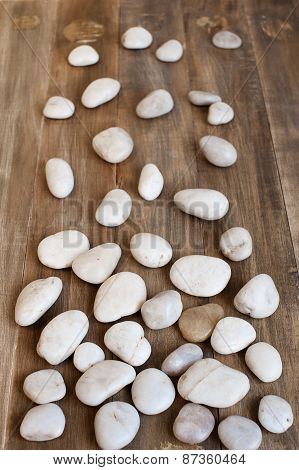 Pebble On The Distress Wooden Background