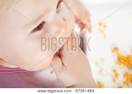 Overhead Baby Eating With Hand