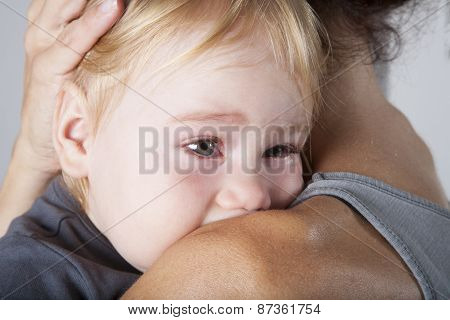 Tears In Baby Eyes Embraced Mother