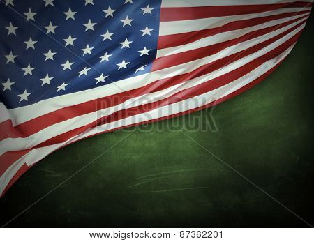 Closeup of American flag on green background
