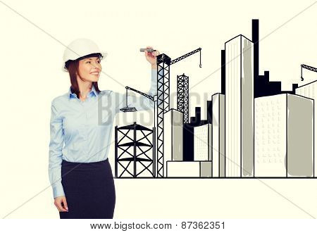 building, developing, consrtuction and architecture concept - smiling businesswoman in white helmet drawing city sketch on virtual screen