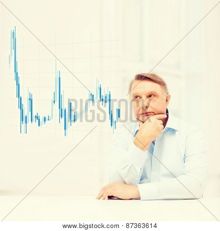 oldness, business, money and people concept - stressed old man with forex chart holding head at home