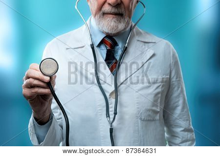 male doctor holding a healt instrument