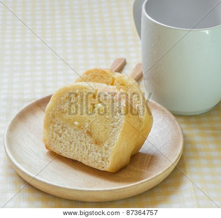 Butter Cake Sliced On Wooden Dish And Coffee Cup, Soft Focus