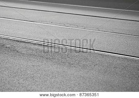 Textured Asphalt Surface With Rails