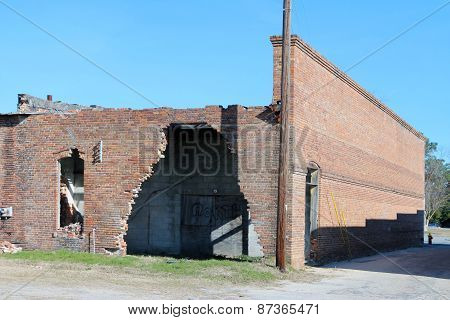 Abandoned and damaged brick building