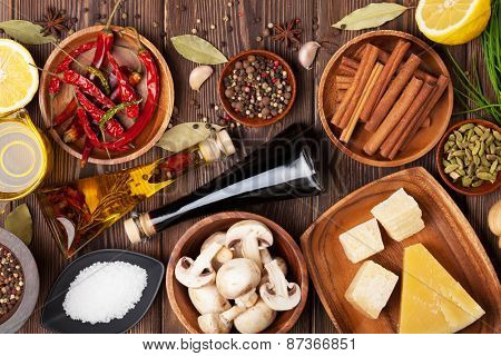 Various spices on wooden background. Top view