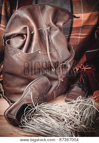 Leather Products Against The Background Of Wool Tartan