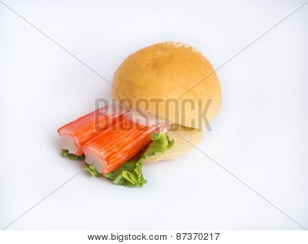 Crap-stick hamburger on white background