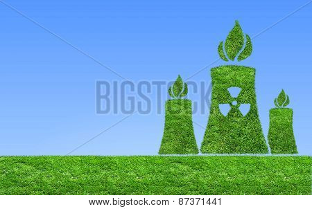 Green nuclear power plant icon on meadow .