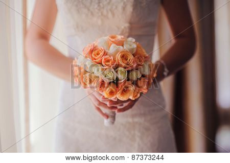 Bride Holding A Wedding Bouquet With White And Pink Roses