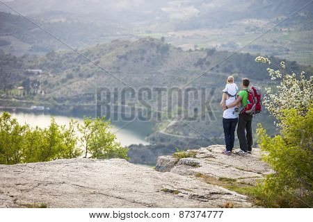 Couple with toddler boy standing on cliff