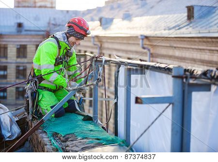 Industrial climber on roof of a building