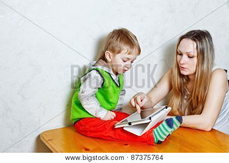 Mom And Son Playing With Tablet Pc