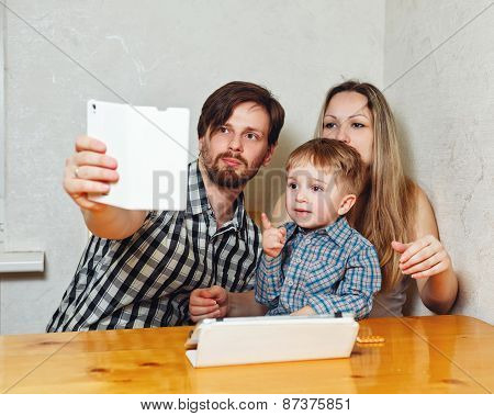 Family Mother, Father And Son Are Doing Selfie