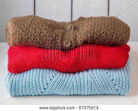 Stack Of Women's Sweaters And Cardigans.
