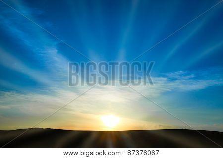 Sun Rising On The Blue Sky