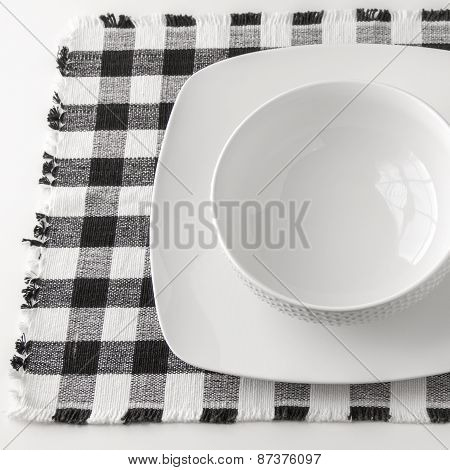 Empty White Bowl And Plate  On Napkin