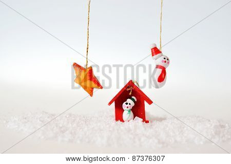 Snowman House And Star On White Background