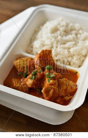 Chicken curry with rice in a disposable container