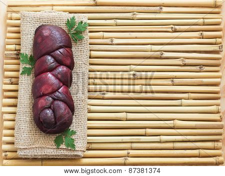 Homemade Braided Mozzarella Marinated In Red Wine On Sackcloth, Bamboo Board