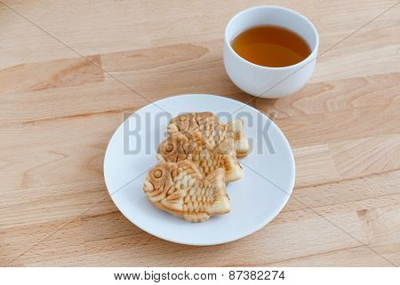 Japanese confectionery taiyaki fish cake wagashi on plate with tea