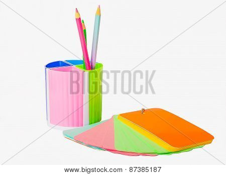 Notebook And Glass Of Crayons
