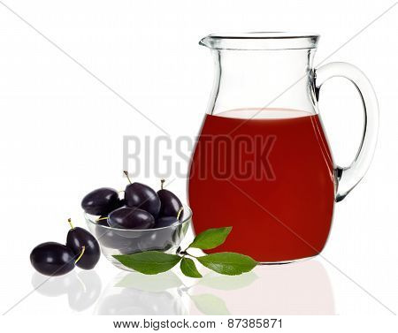 Plum Juice In A Carafe On A White Background