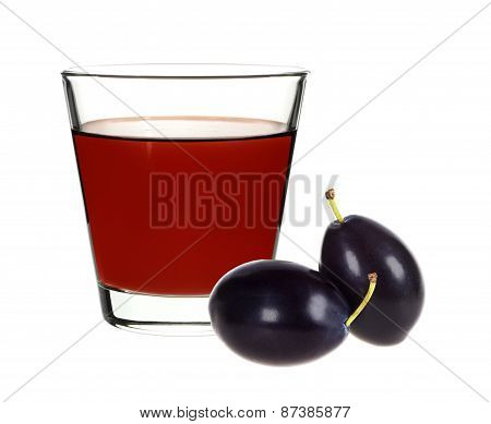 Plum Juice In A Glass With Plums