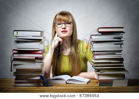 Famale Student With Many Books