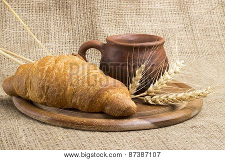 Clay Cup Milk, 2 Croissants On A Wooden Stand, Wheat Spikelets, Sacking