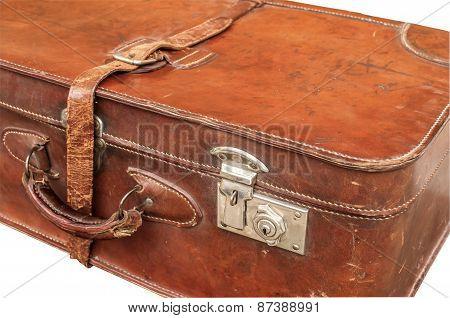 Old retro leather suitcase on white