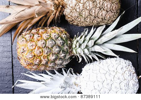 Fancy, white pineapple on the wooden table