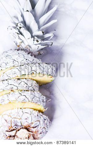 Fancy, white pineapple on the board