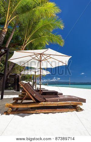 Sun Umbrellas And Beach Chairs On A Beautiful Island, Boracay