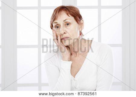 Senior woman, worried